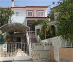 Huis vlak bij zee met zeezicht