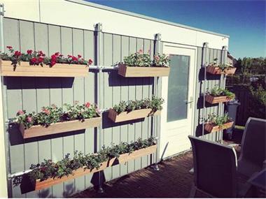 Grote foto verticaal tuinieren tuin en terras bloembakken