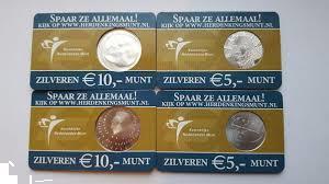 Grote foto de eerste 4 coincards uitgegeven door de knm postzegels en munten nederland