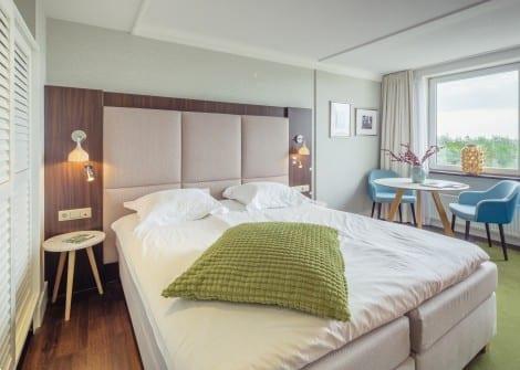 Grote foto kamer luxe tweepersoonskamer ontbijt de koog vakantie nederland noord