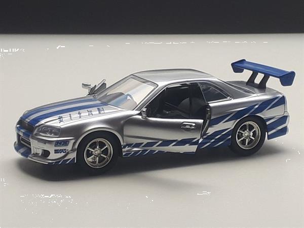 Grote foto nissan skyline r34 2 fast 2 furious modelauto 1 32 verzamelen speelgoed