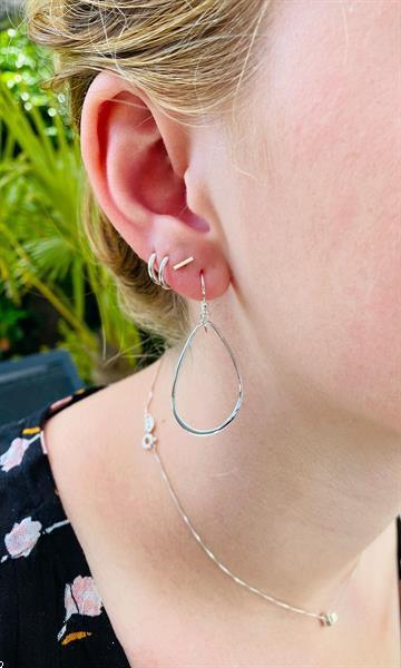 Grote foto zilveren open peer vorm oorhangers sieraden tassen en uiterlijk oorbellen