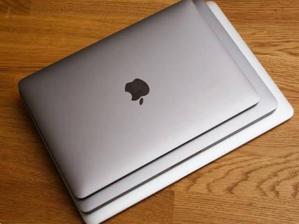 Grote foto gloednieuwe apple macbook pro computers en software desktop pc
